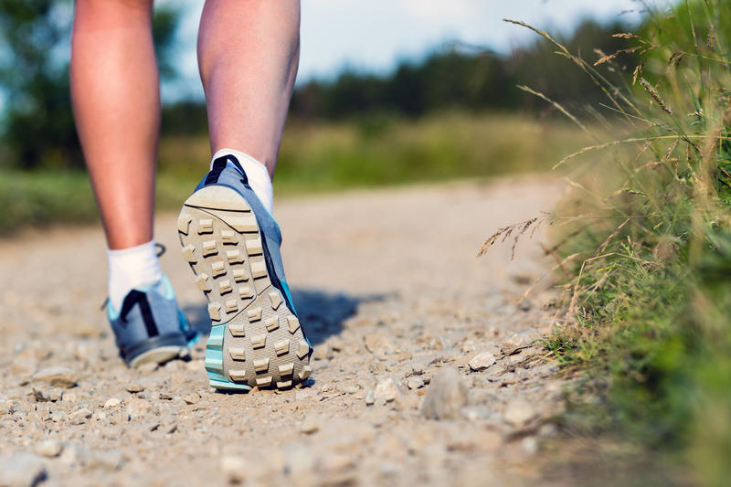 Woman walking in sports shoes, sport and fitness outdoors