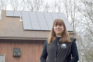 Liz Moniz had solar panels installed in her home in January 2015. She's able to track how much she's saving and how much energy the panels produce.